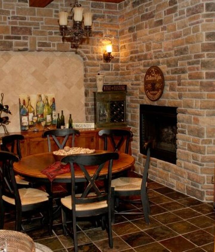 Not only richly detailed with stone surround, but accented nicely with fireplace (1 of 5 in the home), full wet bar with wine refrigerator and hammered copper sink basin, but chandelier and custom mill-working.