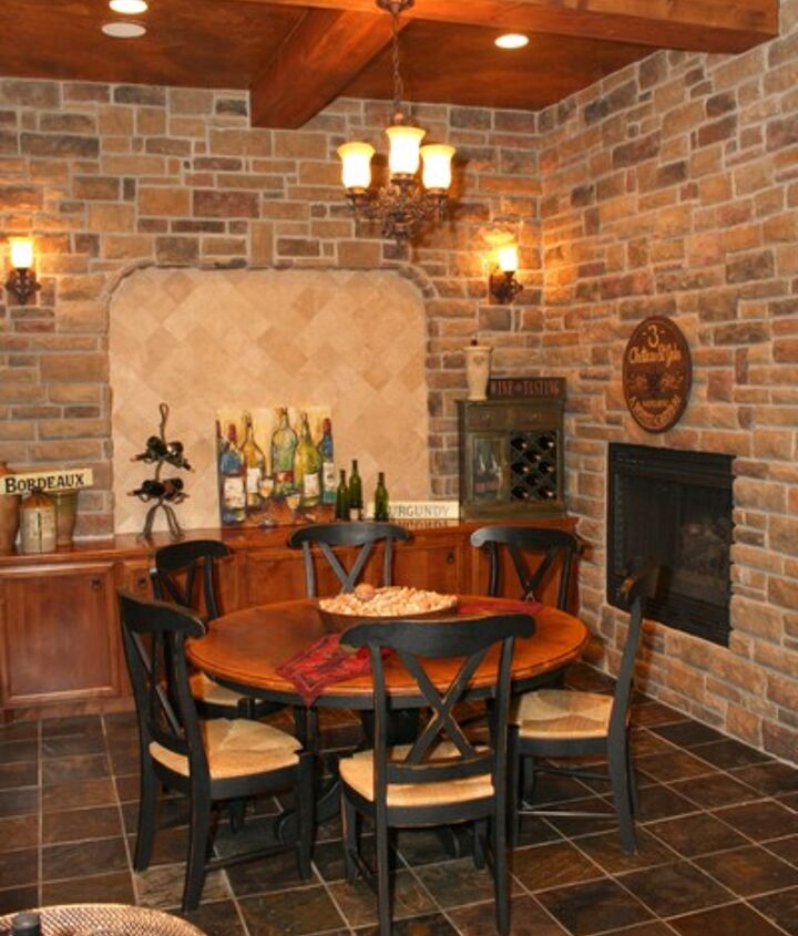 The ceiling is even elaborate with exposed beams, and the floor is slate! You can easily enjoy this space for wine tastings, informal dining and game playing! Poker anyone?
