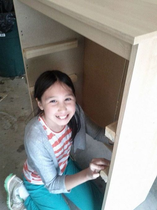 My little helper, Diana.  We used 2x2 to hold the sides and the shelves are MDF.