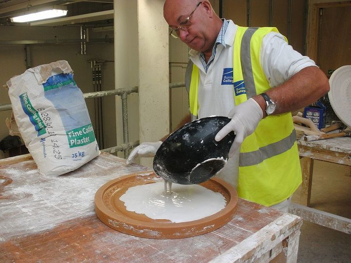 Once mixed  to a creamy consistency the plaster is poured into the centre of a clean flood mould , making sure that all the mould is covered. This is called the firstings.
