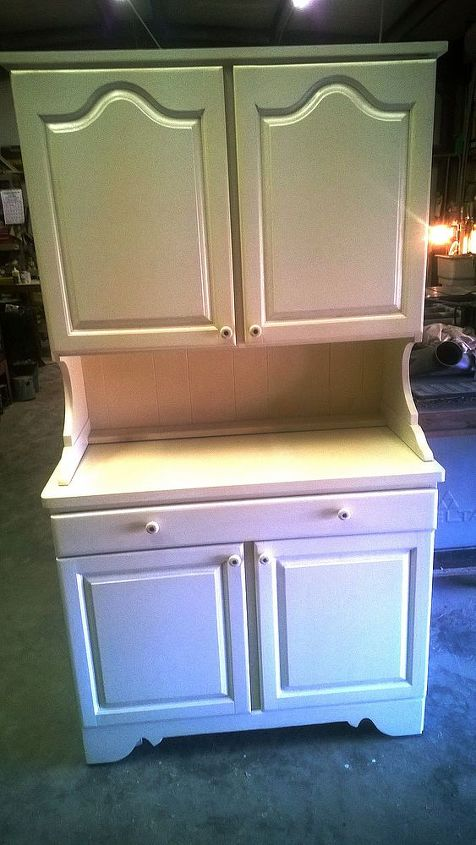 I made 4 raised panel doors. Two with arched tops and two with straight tops. I added the 120 degree Euro hinges so that they would not show and he can remove the doors with the push of a button,