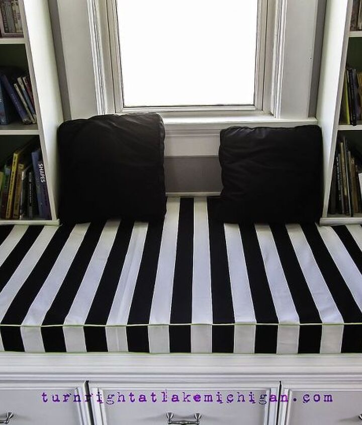 The window seat cushion was another IKEA hack -- we bought the least expensive foam mattress and cut it to fit around the bookcases. I then sewed a removable, reversible cover out of IKEA fabric and lime green piping.