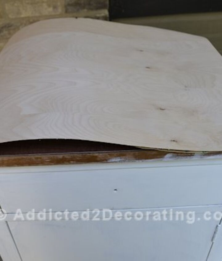 Covering the laminate top with adhesive-backed real wood veneer.