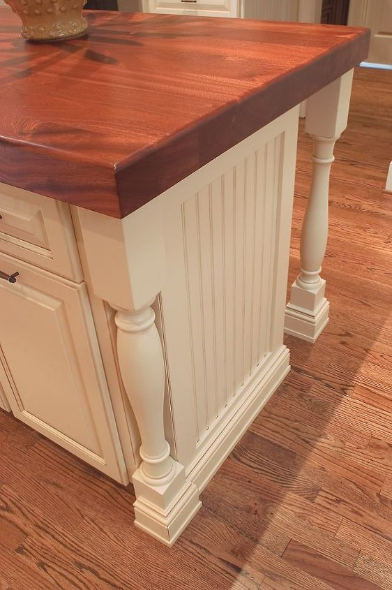 Another example of flush baseboard.  Note it also wraps the turned legs.   Common parts.. enhanced.
