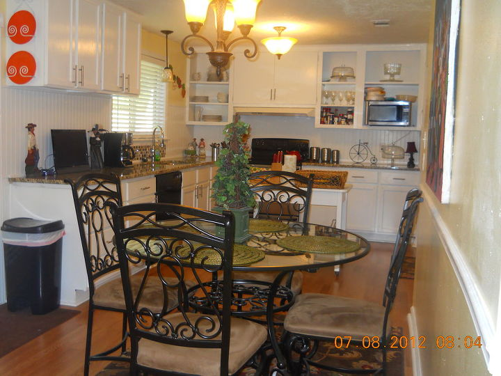 2012 August  after granite installation, laminate floors, painting the walls Glidden's Lemon Ice and so forth and so on