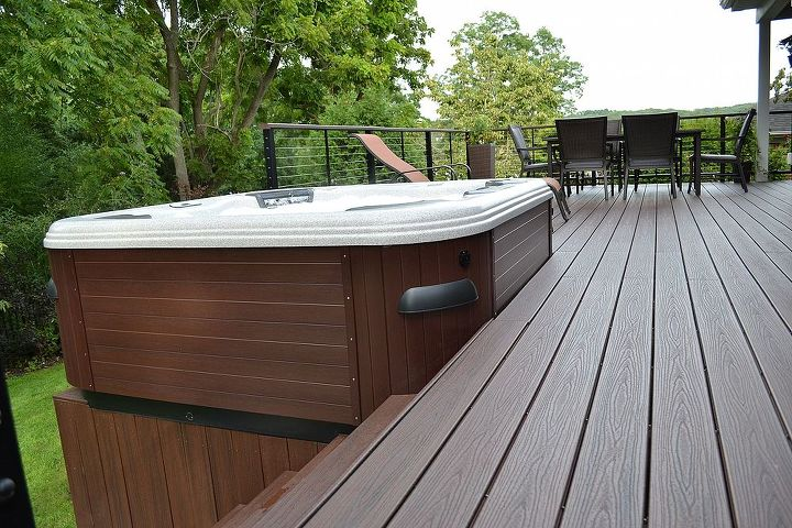 "Trex Transcend Decking: The Bullfrog Spa's base, framed in PVC boards, harmonizes beautifully with the project's ""vintage lantern"" Trex Transcend decking."