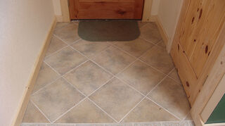 would like comments on the transition look of a tile floor to a hardwood floor, flooring, hardwood floors, tile flooring, entry tile with caulked joint to bamboo