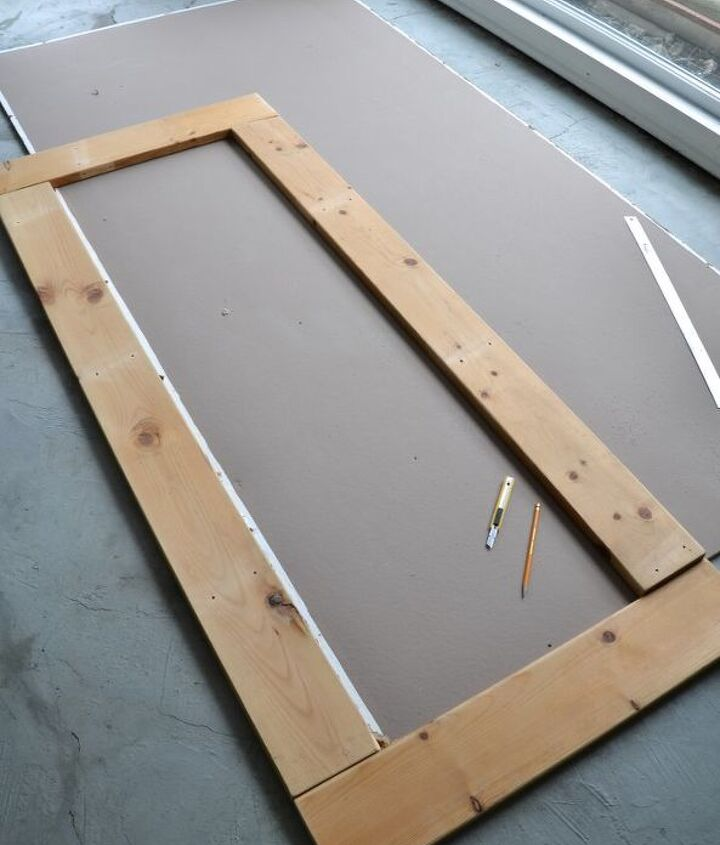 A frame was cut down to the desired size, then used as a template to trace out the bulletin board section from a piece of leftover fibre board sitting around.