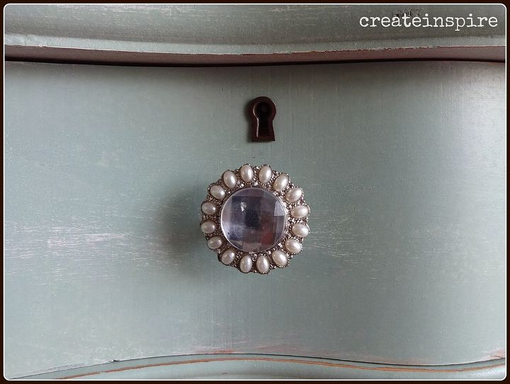 ...replaced the wooden knobs with these pretty, vintage knobs.