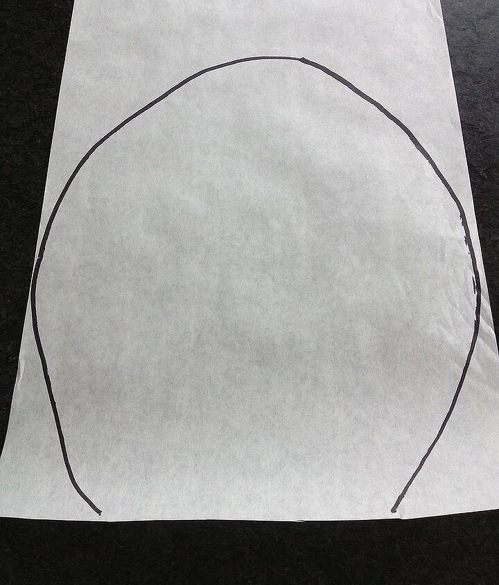 I traced the shape of the hole in the tree on a large piece of paper.