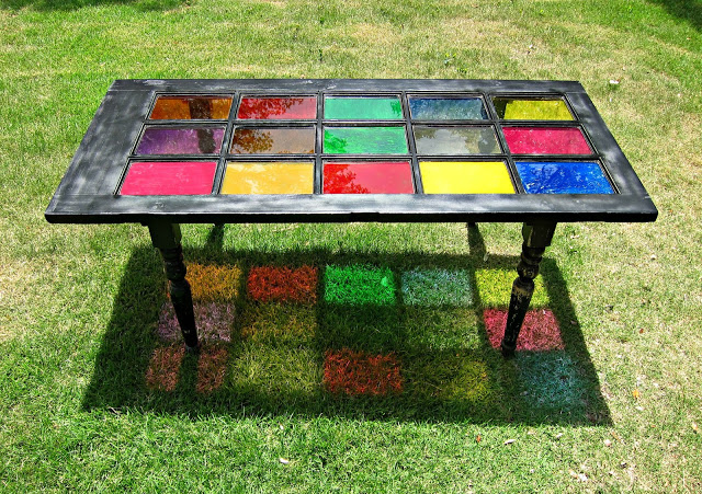 I love the way the light reflects the colors on the ground!  My kids are enchanted by it, as well, and it adds to the whimsy of our little garden spot.  http://www.morenascorner.com/2013/08/dont-trash-it-how-to-repurpose-table.html
