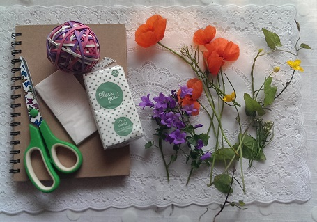 1/Make a microwave flower press from a cheap notepad..