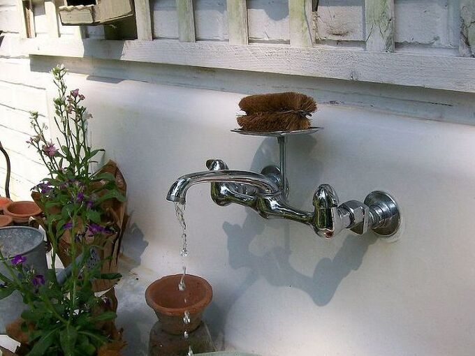 my favorite garden repurpose potting sink fountain, gardening, outdoor living, seasonal holiday decor, thanksgiving decorations, Our 1916 cast iron sink now serving as a fountain and potting bench