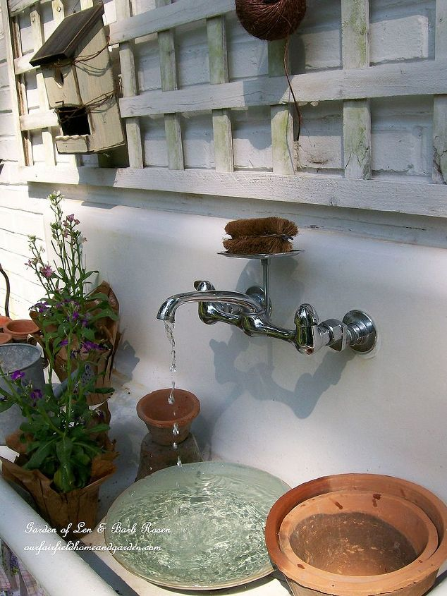 Our 1916 cast iron sink now serving as a fountain and potting bench.