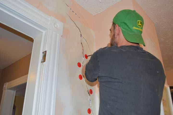 "Installing plaster washers using a 2"" inch drywall screws into some of the holes."