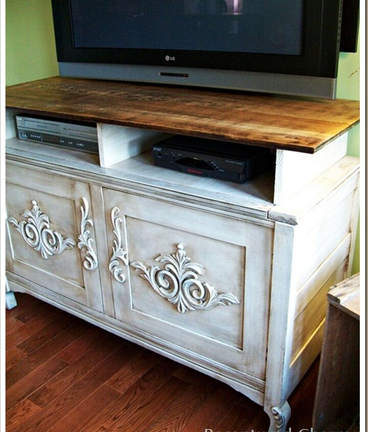 Old solid wood chest found at the curb had the front doors nailed shut and a removable top. Now it sits proudly as a beautiful entertainment unit.