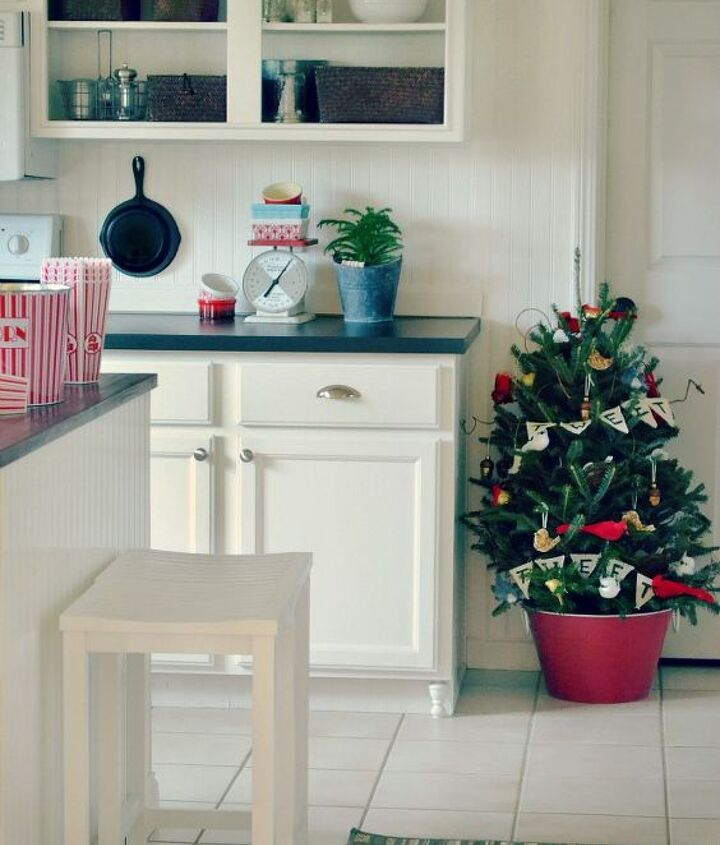 A fresh tree in the kitchen makes for a fun and festive touch!