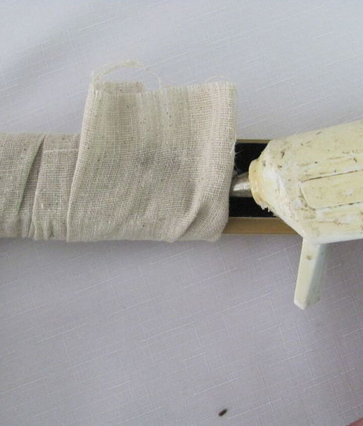 At the end of the strip - glue it down on the back and trim any excess fabric.