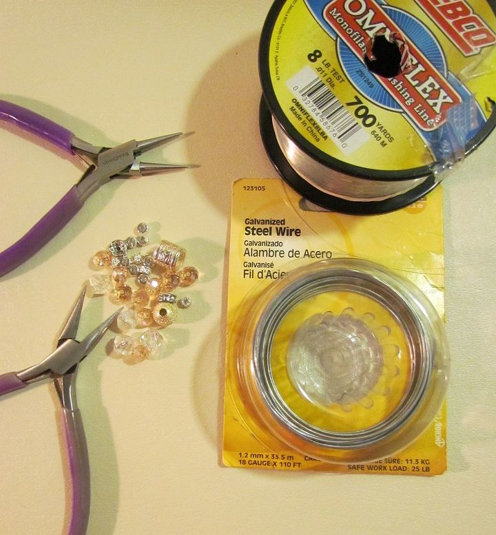 18 or 16 gauge wire. Beads, Needle nose and round nose pliers, monofilament fishing wire.
