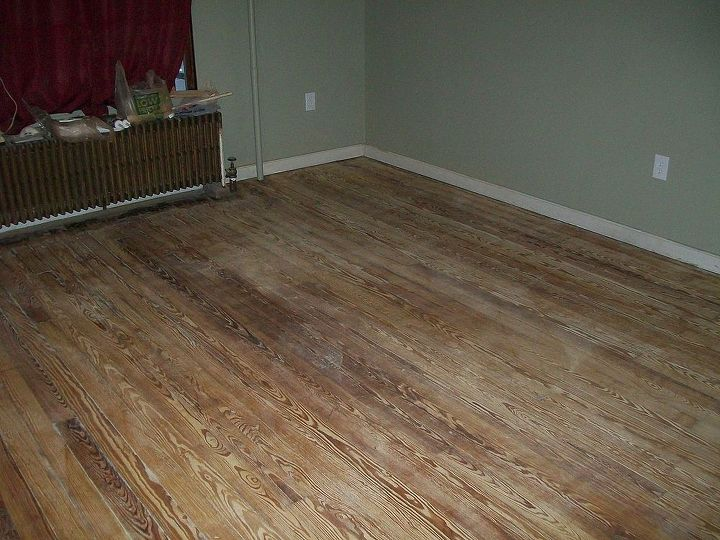 After several days of dancing with a floor sander.  The glue was a mess to work with, it ruins the sandpaper fast.