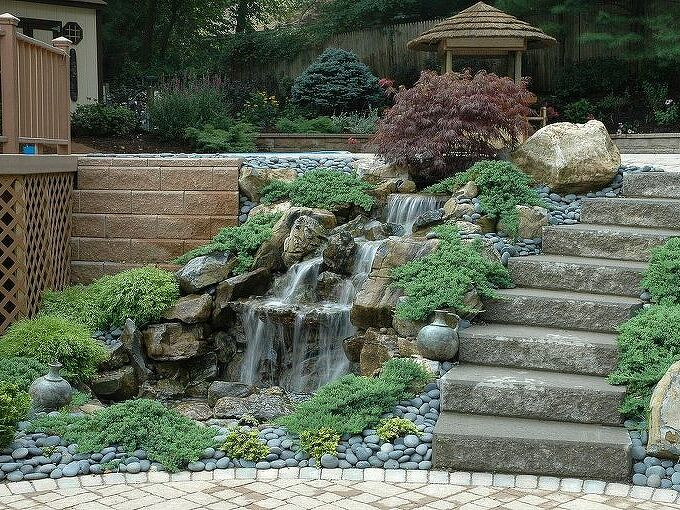 turn a boring retaining wall into an exciting safe water feature, landscape, outdoor living, ponds water features, How do you add pizzazz to a normally boring retaining wall Install a pondless water feature Yes Pondless this mean that the water is underground and in a safe area where children can t access it This pondless waterfall was built in