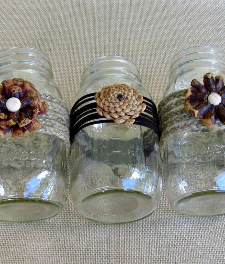 We used jute twine and leather to wrap the mason jars before adhering the pine cone flowers.