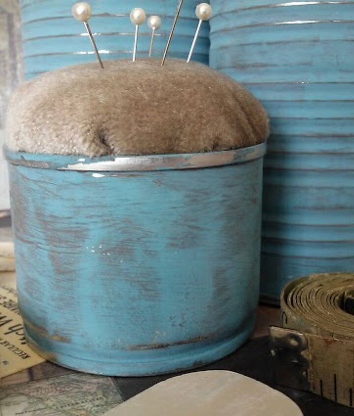Create a pin cushion out of a shallow tin can.