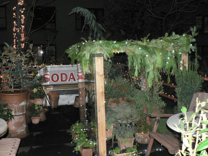 """Cold Frame CLOSED (NIGHT) Year Two: Draped in Garland (Image featured in """"I've never seen a billboard lovely as a tree"""" @ http://www.thelastleafgardener.com/2011/05/ive-never-seen-billboard-lovely-as-tree_14.html)"""
