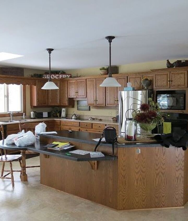 Here are the cabinets... lots of wood in the kitchen.  The island is going to be painted BM Buckhorn (darker brown)