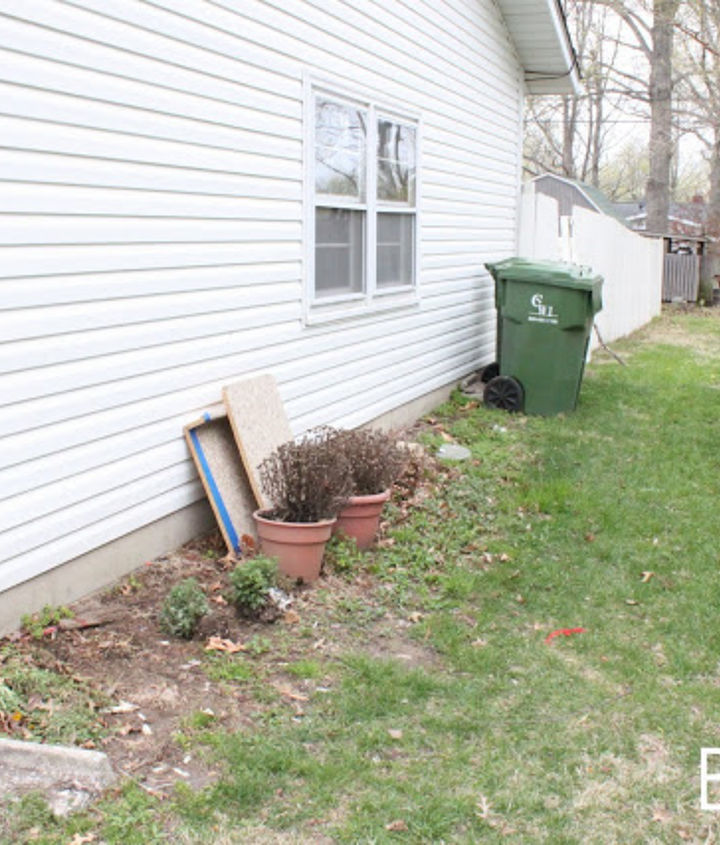 side yard makeover creating curb appeal, curb appeal, gardening, landscape, Here is a look at the side yard just a couple years ago It was more of an eyesore than anything else and definitely lacked curb appeal