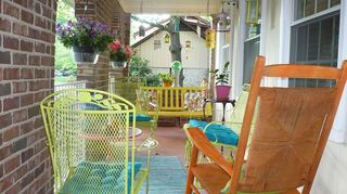 q i want an inexpensive way to decorate my porch with a simple wooden chair some paint, curb appeal, flowers, outdoor furniture, outdoor living, painted furniture, porches
