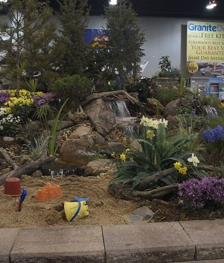 What better to have at the end of a pondless waterfall - a sandbox complete with toys!