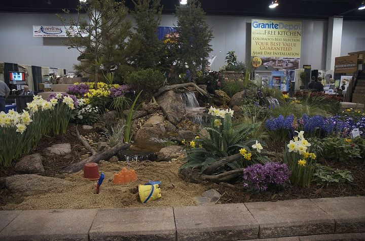 its garden and home show season in colorado, outdoor living, ponds water features, What better to have at the end of a pondless waterfall a sandbox complete with toys