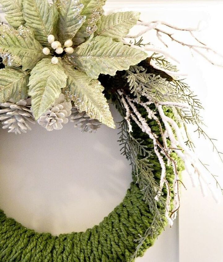 A frosted green poinsettia and frosted branches make up the bulk of this easy-to-do wreath.