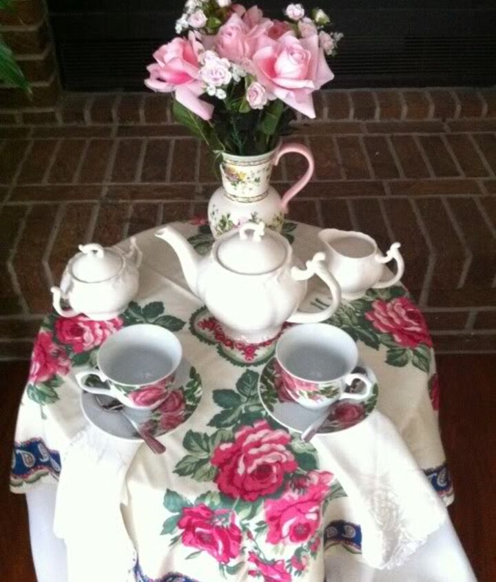 A tea for two table is set.