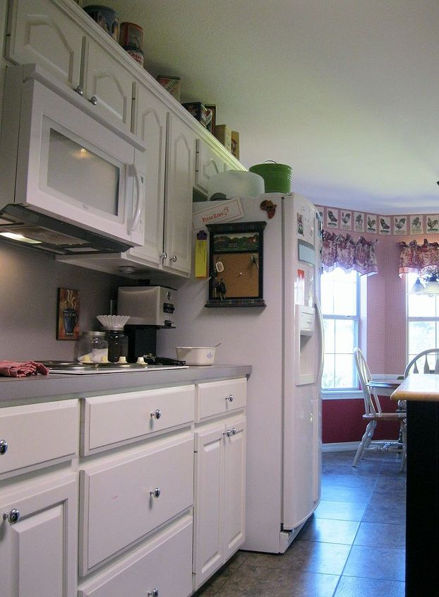 Before-The left side with stove top and fridge (notice the formica that is wrapped up the wall) looking toward the breakfast nook
