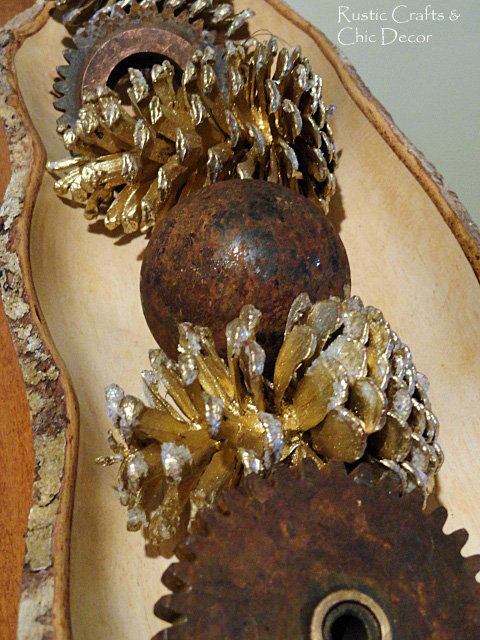 I combined rusty metal gears and an iron ball with gold pine cones for a nice contrast.