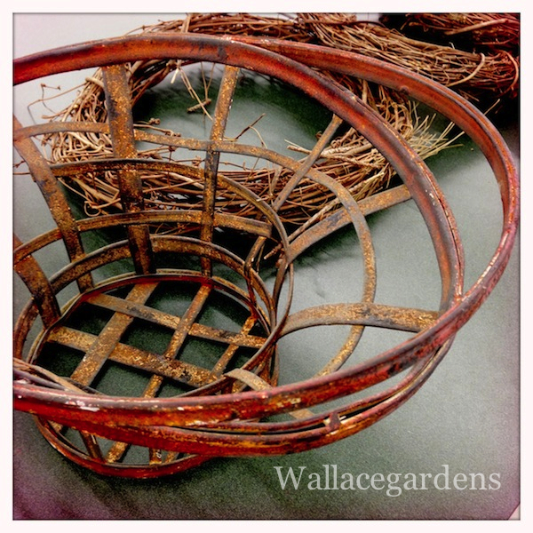 "I love these large, ""iron-wicker baskets."" A few of them are being transformed into Autumn Arrangements."