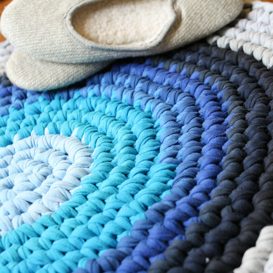 crochet t shirt rug, crafts, flooring, home decor, Cut the t shirts to create yarn and crochet it in the round to create a circle tying each new color on as you go
