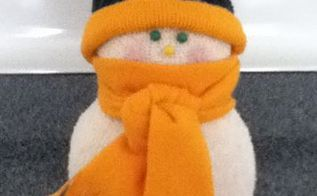 sock snow people, crafts, seasonal holiday decor, This one I made for my mother in law who is Packer fan His hat is made from the band of my husbands old thermal sock and the band from an old shirt A little hot glue is all it took Actually anything is all cut from an old shirt