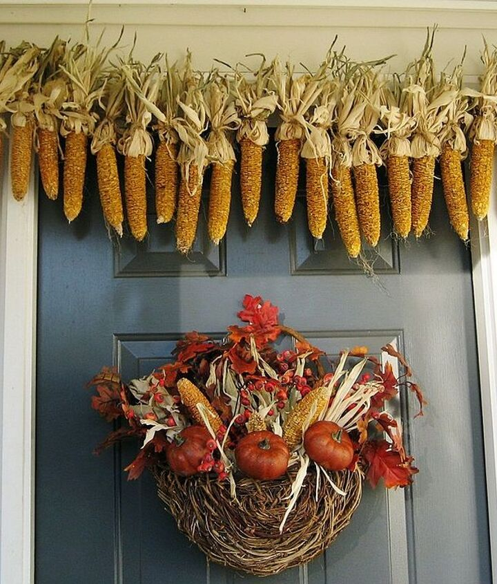 My corn garland and thrifting find basket filled with leaves, pyracantha berries, dried corn and pumpkins