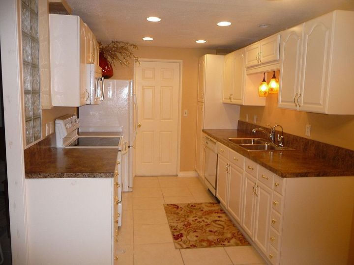 """After...cream painted cabinets, granite look countertop, """"Sunbaked"""" paint color"""