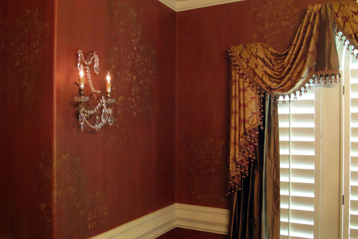 CLOSE UP  Artistic finish on the walls works as an elegant backdrop and blends with the custom window treatments.