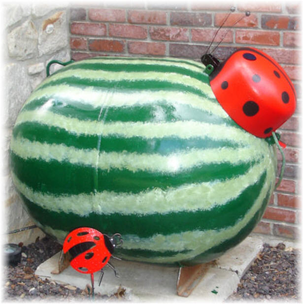 I painted my propane tank to look like a watermelon with a ladybug on top.