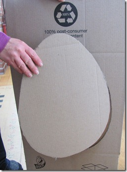 I started with a cut out cardboard egg shape.