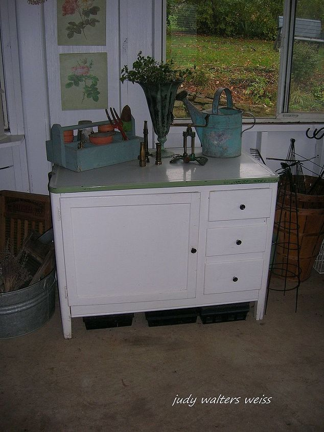 The old Hoosier holds vases & other floral supplies