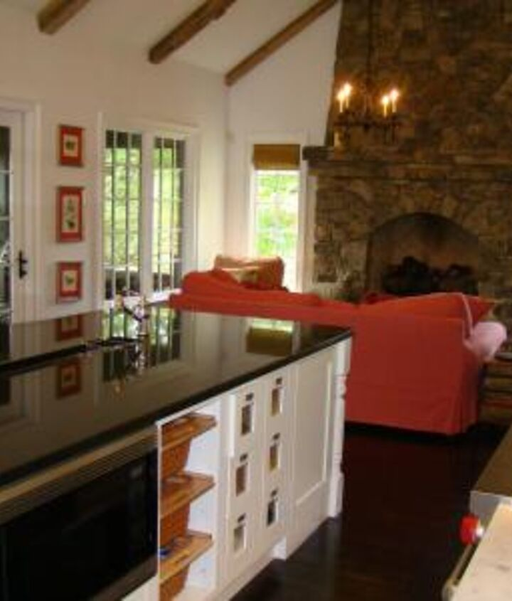 How about this keeping room fireplace?  http://blog.akatlanta.com/2012/11/kitchen-fireplaces-keeping-rooms.html