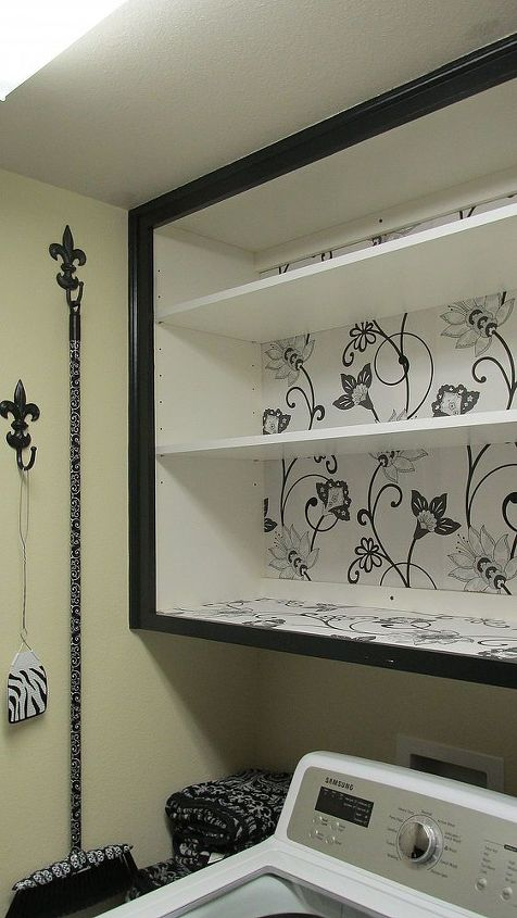 I painted the cabinets using Maison Blanche Wrought Iron Vintage Furniture Paint. I used three coats of paint &  topped it with Min-Wax poly-Acrylic Satin Finish Clear Coat. I used 3 coats of the poly. I used a fun modern floral print in grays, black, white & silver for the back of cabinet, the shelves & the cabinet door panels, to add a touch of whimsy.