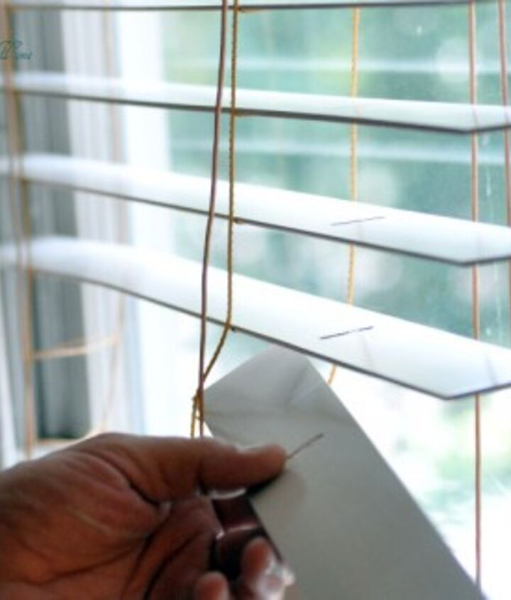 "We set up a table with all the slats lined up-painted one side-let dry-paint other side. When dry, thread the slats into their ""hammocks"" & thread the strings back through the slits in the slats and tie off at the bottom!"