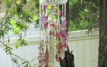 make your garden sparkle with crystals, gardening, outdoor living, Made 14 crystal tassels with Beadalon 49 count stainless steel wire hung each tassel on steel chains at varying lengths Attached each to a circle made of 18 gauge steel wire with round crystals strung between each tassel